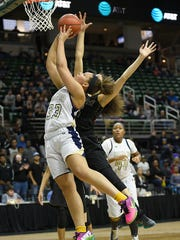 Senior guard Destiny Pitts (33) was Country Day's emotional floor leader who won two state championships during her stellar prep career.