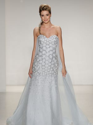 A model walks the runway wearing Disney Fairy Tale Weddings by Alfred Angelo Collection at EZ Studios on October 8, 2014 in New York City.