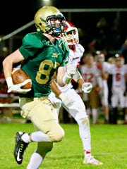 York Catholic's Riley Brennan runs after a catch during