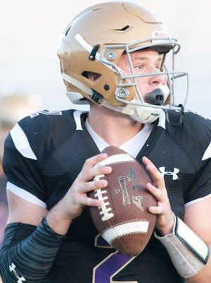 Male quarterback Cameron Chesher prepares to throw the ball.20 September 2017