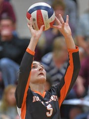 Ashley Now (5) of North Fond du Lac sets the ball.