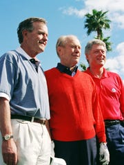 President Bill Clinton, right, is joined by Presidents George H.W. Bush, left, and Gerald Ford for a formal portrait before beginning a round of golf together in the Pro-Am round of the Bob Hope Chrysler Classic in Indian Wells on Feb. 15, 1995.