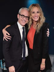 Jess Cagle, shown here with Julia Roberts on Nov. 2, will be inducted Friday into the Cooper High School Hall of Fame.
