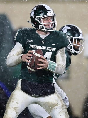 Brian Lewerke of the Michigan State Spartans throws a pass against Maryland on Saturday, Nov. 18, 2017 at Spartan Stadium.