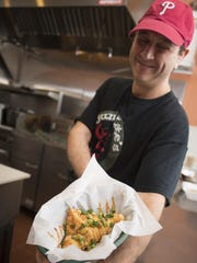 Chef/Owner Don Applebaum serving up Crawfish pie at