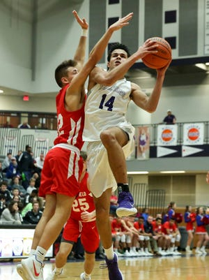 Pierce Thomas drives to the basket for Brownsburg against Plainfield.