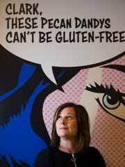 Jill Bommarito, CEO and Founder of Ethel's Baking Co., in front of a sign from the company's first food show when they first began disturbing the baked goods, on Wednesday, Feb. 28, 2018 at Ethel's Baking Co. in St. Clair Shores.