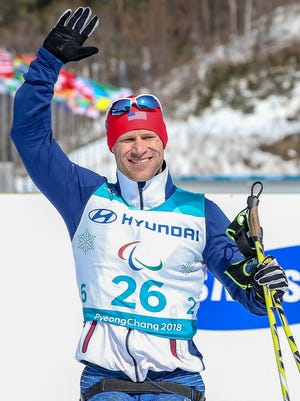 Dan Cnossen of the United States celebrates after after crossing the finish line in second place during the men's cross-country 15K sitting event at Alpensia Biathlon Centre during day two of the PyeongChang 2018 Paralympic Games on March 11.