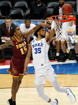Duke's Marvin Bagley III (35) makes a shot with Iona's Deyshonee Much (15) defending during the first half of an NCAA men's college basketball tournament first-round game, in Pittsburgh, Thursday.
