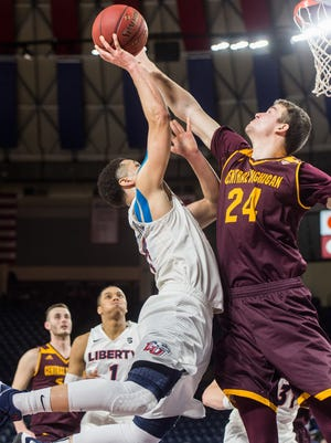 Liberty's Georgie Pacheco-Ortiz, left, shoots over Central Michigan University's Luke Meyer during the second half.