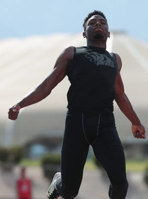 James Green competes in the long jump at Cathedral City High School, Thursday, April 5, 2018.