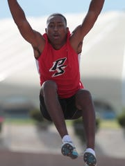 Damian Loman competes in the long jump at Cathedral