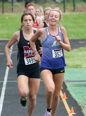 Male's Kaitlyn Lacy is all smiles as she leads the pack int the girls 3200-meter run of the KHSAA Class 3A Region 3 track and field meet at Male High School. She came in first with a time of 11:30.03 beating duPont Manual's Kathleen Simms who came in second with a time of 11:34.03 seconds.May 12, 2018