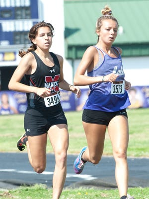 Male's Kaitlyn Lacy (right) will be a favorite, along with the rest of the Bulldogs' girls track team, to take home another state title this weekend.