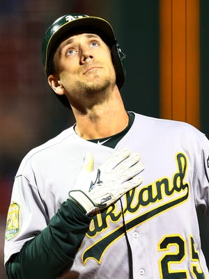 Stephen Piscotty reacts as he crosses home plate on his solo home run.
