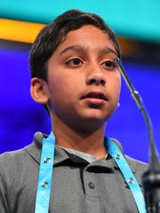 Atman Balakrishnan from Illinois spelled the word cantico correctly during the 2018 Scripps National Spelling Bee at the Gaylord National Resort and Convention Center.