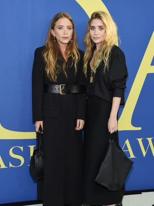 Mary-Kate and Ashley Olsen, 2015's designers of the year, surprised no one by wearing black.