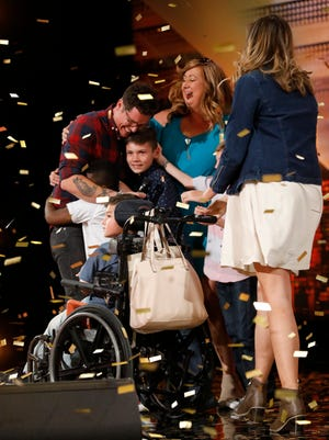 "Knoxville's Michael Ketterer embraces his family after auditioning for ""America's Got Talent"" on Tuesday, June 5, 2018. He earned the show's Golden Buzzer from Simon Cowell, which will advance him to the ""AGT"" live shows."