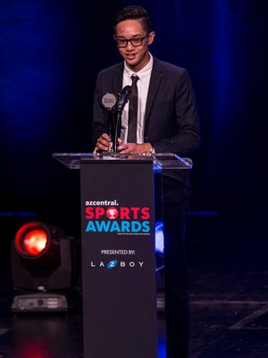 Queen Creek's Gabriel Salvanera accepts the award for Boys Golfer of the Year during the azcentral Sports Awards at ASU Gammage in Tempe June 10, 2018.
