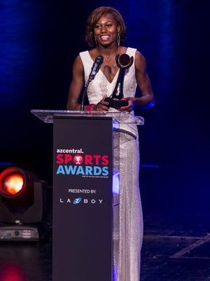 Chandler's Jai Gruenwald accepts the award for Girls Track and Field Athlete of the Year during the azcentral Sports Awards at ASU Gammage in Tempe June 10, 2018.