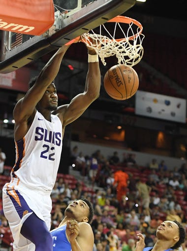 Deandre Ayton #22 of the Phoenix Suns dunks against Antonio Campbell #29 and Jay Wright (R) #3 of the Orlando Magic during the 2018 NBA Summer League at the Thomas & Mack Center on July 9, 2018 in Las Vegas, Nevada. The Suns defeated the Magic 71-53.