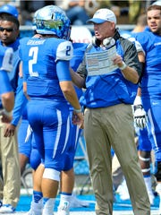 Middle Tennessee Blue Raiders head coach Rick Stockstill talks to Middle Tennessee quarterback Austin Grammer (2) during the first half against the Southern Miss Golden Eagles at Floyd Stadium, on Oct 4, 2014 in Murfreesboro, Tenn.. Middle Tennessee won 37-31.