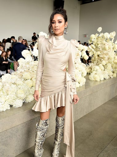 Shay Mitchell opted for thigh-high snakeskin boots