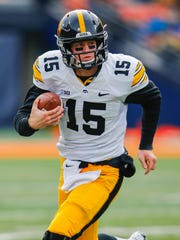 Jake Rudock #15 of the Iowa Hawkeyes runs the ball