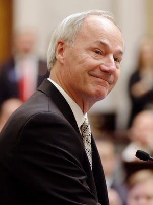 Gov. Asa Hutchinson looks at the House chamber before speaking to a joint session of the Legislature at the Arkansas state Capitol in Little Rock on Tuesday.