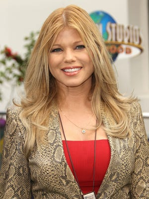 """Donna D'Errico attends the premiere of """"Hop"""" in March, 2011 in Universal City, Calif."""