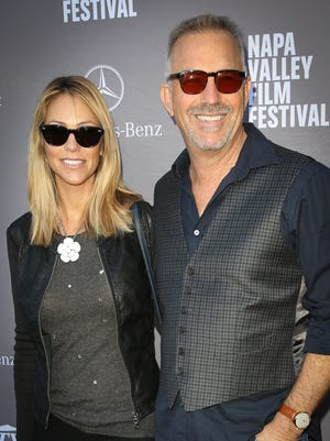 Actor Kevin Costner, right, and wife Christine Baumgartner attend the Variety 10 producers to watch and indie impact presented by Mercedes-Benz at The Culinary Institute of America on November 15, 2014 in St Helena, California.