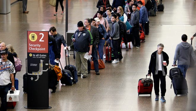 Travelers line up at a security checkpoint in Seattle-Tacoma International Airport on March 24, 2015.