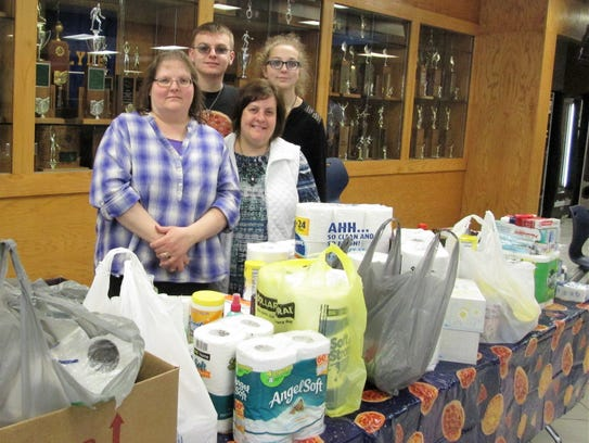 Clyde Back Door Food Pantry event gets help from, left