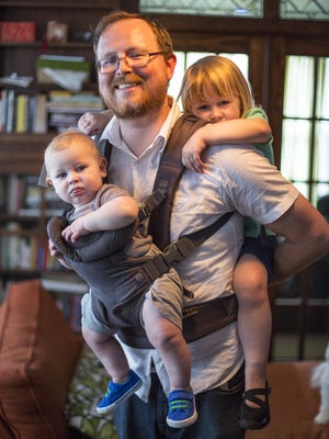 Joe Lawler with daughter, Ava, 3, and son, Jonas, 9 months, at their Des Moines home.