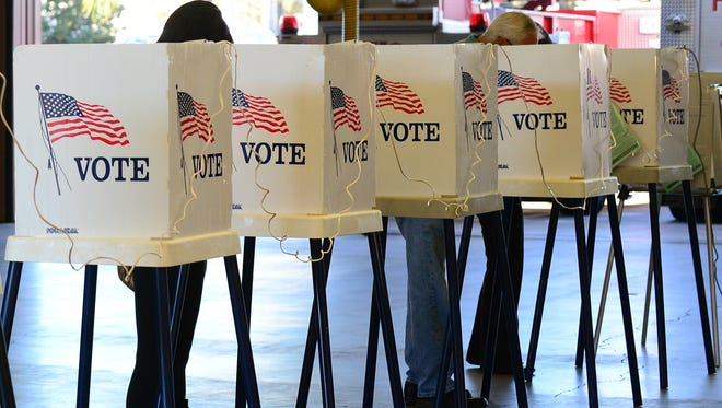 Voters cast ballots in 2012.