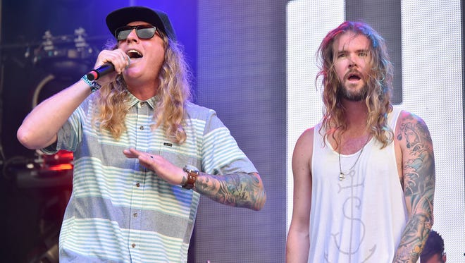 Musicians Dustin Bushnell (left) and Jared Watson of Dirty Heads perform at Firefly Music Festival in 2015. The reggae act will headline Hudson Fields near Milton this spring.