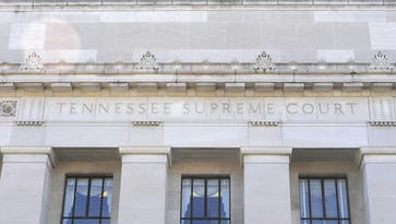 The Tennessee Supreme Court is reviewing a law that sets rules for how school boards fire tenured teachers.