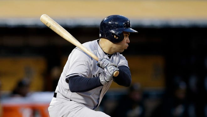 New York Yankees' Carlos Beltran drives in two runs with a double against the Oakland Athletics during the fourth inning of a baseball game Friday, May 20, 2016, in Oakland, Calif.