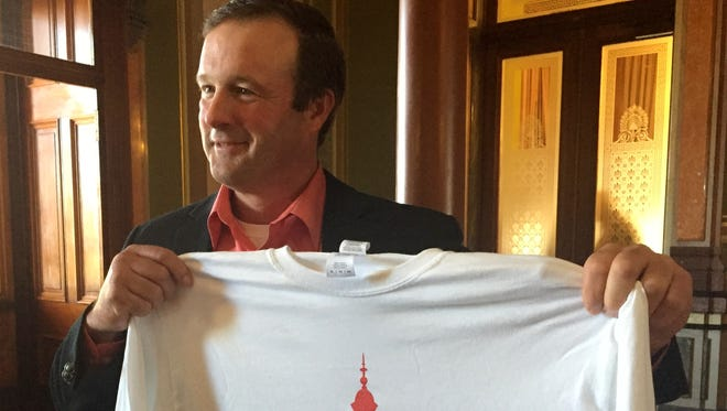 """Newly elected Iowa Senate Majority Leader Bill Dix displays a T-shirt handed out to Senate Republicans at a caucus meeting Friday at the Iowa Capitol. The shirt reads, """"Majority Makers 2016,"""" to celebrate their role in winning control of the Iowa Senate."""