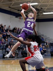 Elie Smith led Fowlerville to a regional final last season, averaging 15.3 points.