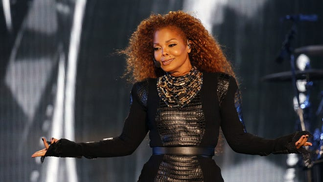 Janet Jackson performs in March 2016, a month before cancelling her world tour.