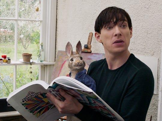 "Peter Rabbit (voiced by James Corden) horns in on Mr. McGregor's (Domnhall Gleeson) action in ""Peter Rabbit."""