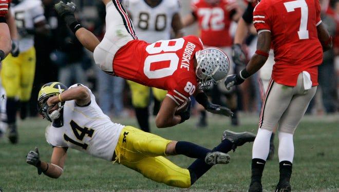 Ohio State receiver Brian Robiskie (80) and Michigan cornerback Morgan Trent collide Nov. 18, 2006, in Columbus, Ohio.
