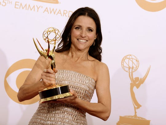 """A 2013 file photo shows actress Julia Louis-Dreyfus backstage with the award for outstanding supporting actor in a comedy series for her role on """"Veep"""" at the 65th Primetime Emmy Awards in Los Angeles."""
