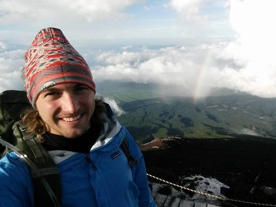 Hunter Sipes poses for a photo while he climbs Mount Fuji during a recent trip to Japan. Sipes is a Stevens Point native.