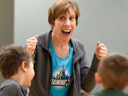 Instructor Candy Ruffolo leads a laughing yoga class for two YMCA 4K classes and about 10 adults on Feb. 1.