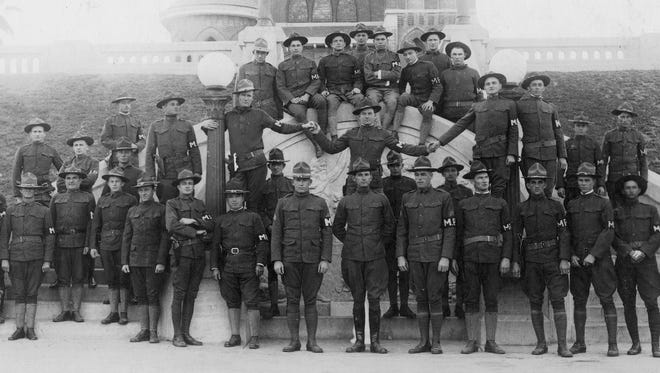 Camp Scurry MPs gather around the Confederate Memorial Fountain on the bluff in 1917. The MPs occupied office space on the third floor of City Hall between Schatzel and Peoples.