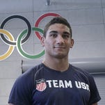 Getting in some reps Tuesday are Team USA junior wrestlers Alec Pantaleo (left) and Sal Profaci, from New Jersey.