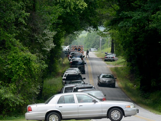 Pickens County Sheriff's deputies respond to a standoff situation at a Robert P. Jeannes Road home, after authorities say a man shot a woman. The man was later found dead in his home, after a SWAT team had tried for three hours to get him to come out, Pickens County Sheriff Rick Clark said.