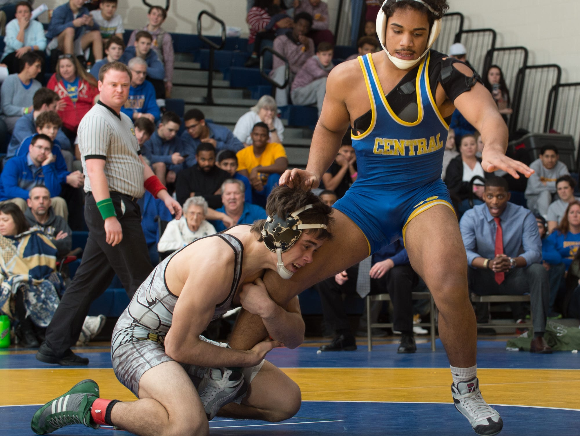 Cape Henlopen's Cory Lawson, left, hold the leg of Sussex Central's Brandon Bautista in the 160 pound championship match at the Henlopen Conference wrestling tournament at Sussex Central High School.